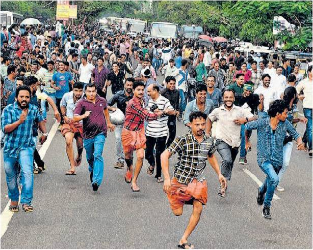 Spectators running on police lathi charge