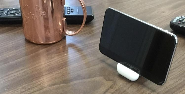 best service c64f3 9bf81 The AirPods Case Makes up for a Perfect iPhone X Stand | Beebom