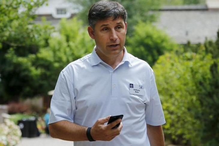 FILE PHOTO: Chief Financial Officer of Twitter Noto holds his phone during the first day of the annual Allen and Co. media conference in Sun Valley