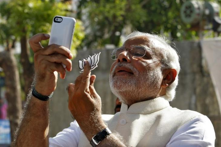 """Hindu nationalist Narendra Modi, prime ministerial candidate for India's main opposition BJP, takes """"selfie"""" with mobile phone after casting his vote at a polling station during seventh phase of India's general election in Ahmedabad"""