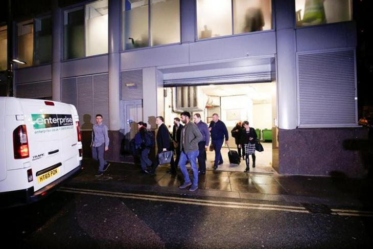 A van and a group of people leave the building which houses the offices of Cambridge Analytica as investigators from Britain's Information Commissioners Office entered, following the granting of a search warrant by a High Court judge, in London