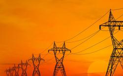 Electric power transmission lines over sunrise