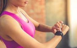 Woman using Fitbit shutterstock website