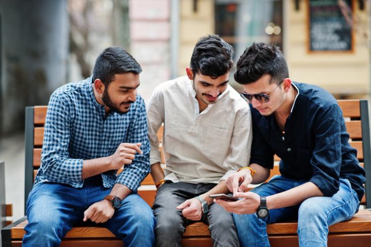 Indian youth using smartphones shutterstock website